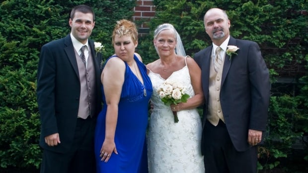 "Tasha Marie Smith, in blue, with her step-parents Linda Smith and Michael Smith on their wedding day. Linda says Tasha loved shopping for the dress and danced all night long at the wedding. ""Classic Punx"", said Linda of Tasha's pose in the photo."