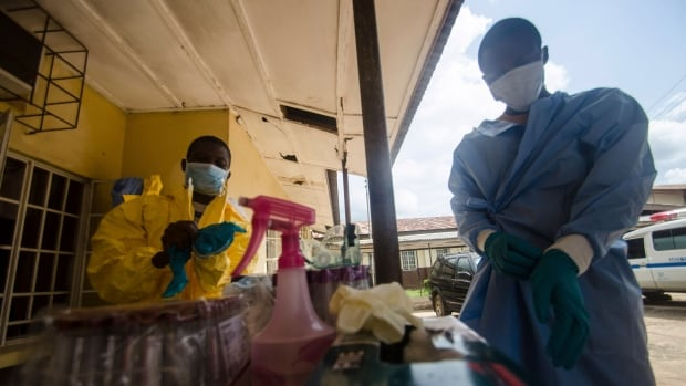 Medical staff put on protective gear in a government hospital in Kenema before taking a sample from a suspected Ebola patient. Ebola has killed more than 600 people across Guinea, Liberia and Sierra Leone since an outbreak began in February.