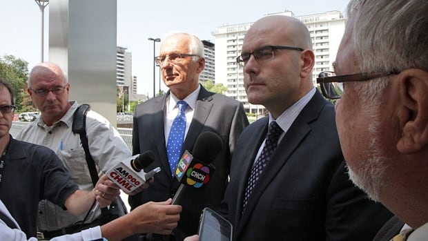 Mayor Bob Bratina and Transportation Minister Steven Del Duca answer questions from the media after a closed-door meeting about Hamilton transit on Friday.