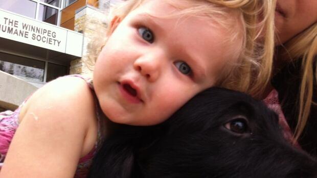 Honey Bea Klassen, who isn't quite 2 yet, calls her new puppy, Pup.