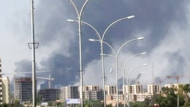 In this July 13, 2014 file image made from video by The Associated Press, smoke rises from the direction of Tripoli airport in Tripoli, Libya. The United States shut down its embassy in Libya on July 26, 2014, and evacuated its diplomats to neighboring Tunisia under U.S. military escort amid a significant deterioration in security in Tripoli as fighting intensified between rival militias, the State Department said.