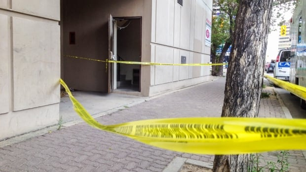 Police taped off an area outside the Holiday Towers on Hargrave St. Saturday. A man was sent to hospital with upper body injuries.