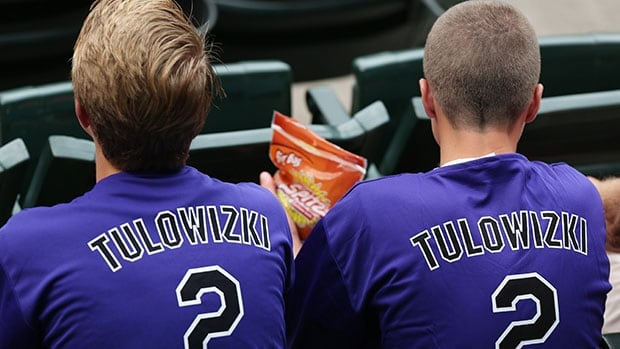 Fans wear shirts emblazoned with the misspelled surname of Colorado Rockies All-Star shortstop Troy Tulowitzki that were given away to attendees as the Rockies hosted the Pittsburgh Pirates on Saturday.