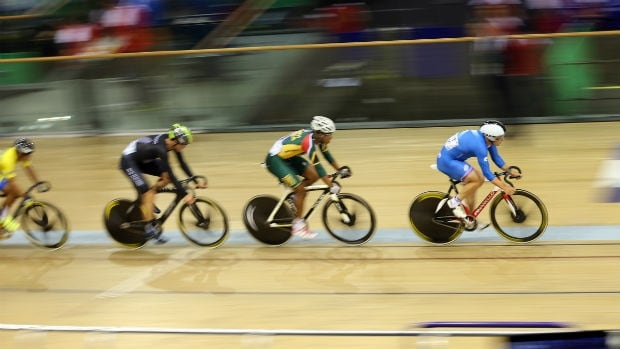 Riders compete in the men's 20 km scratch race in the Chris Hoy velodrome during the Commonwealth Games in Glasgow.
