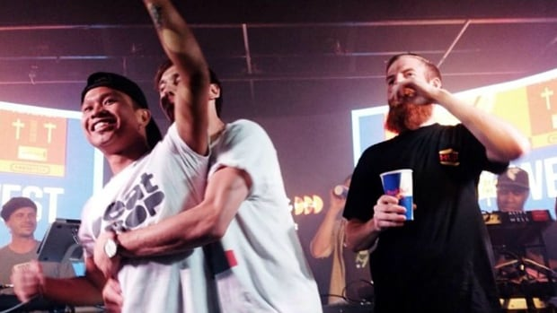 DJ C-SIK, left, reacts after learning he would be one of the DJs representing western Canada in the Red Bull Thre3Style national finals, which he won on Sunday.