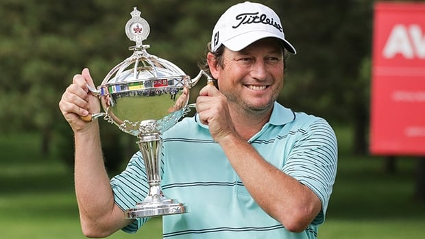 Tim Clark poses with the winner's trophy after capturing the Canadian Open at Royal Montreal in Ile Bizard, Que., on Sunday.