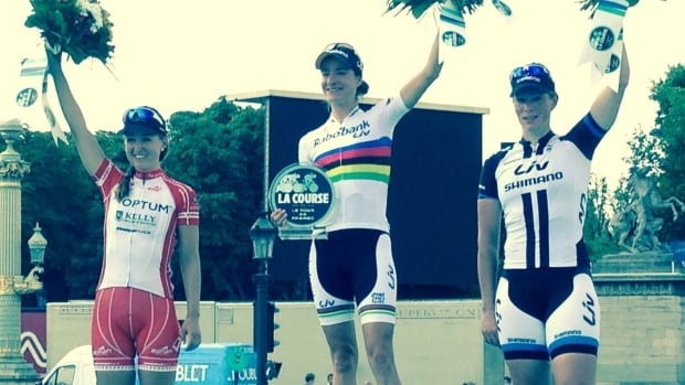 Leah Kirchmann (left) stands on the podium next to first place finisher Marianne Vos of the Netherlands (centre) and Kristen Wild (right), also from the Netherlands, who finished second.