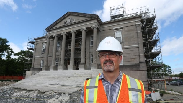 Jerry Dick, director of heritage, culture and recreation, stands outside the historic Colonial Building in St. John's, which is undergoing an extensive restoration project.