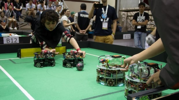 Wheeled robots compete in a two-on-two competition at Robocup 2014 in Brazil. Team SagerSoccer competed in the category of two-on-two robot teams built by people aged 14 to 19 that must use artificial intelligence to operate.