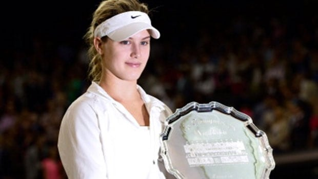Canadian Eugenie Bouchard poses the runners-up trophy after losing to Petra Kvitova in the ladies singles Wimbledon final on July 5.