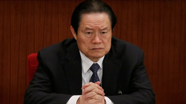 In this photo taken Friday, March 9, 2012, Zhou Yongkang, then Chinese Communist Party Politburo Standing Committee member in charge of security, attends a government session at the Great Hall of the People in Beijing, China.