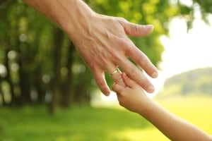 Child's hand holding adult's hand