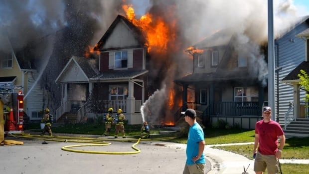 Two homes in New Brighton have been badly damaged in a large fire.