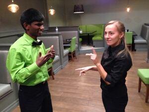 Wait staff use sign language