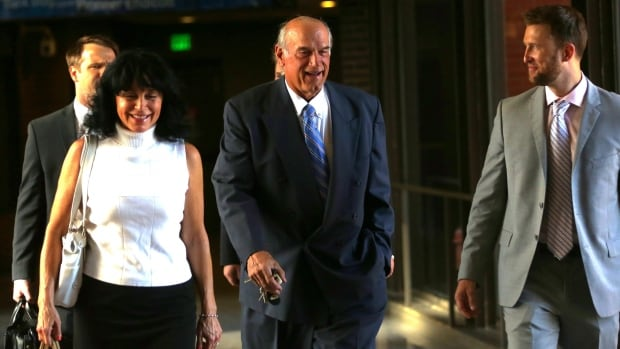 Former Minnesota Gov. Jesse Ventura arrives at a Minneapolis courthouse with his wife.