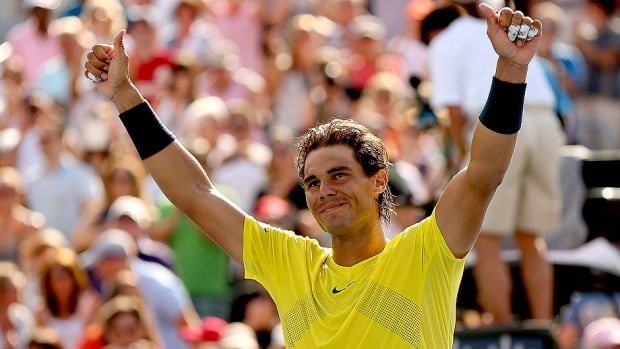 Spain's Rafael Nadal, seen here celebrating his victory in the men's singles final at the Rogers Cup in Montreal, has pulled out of this year's tourney next month in Toronto because of a right wrist injury.