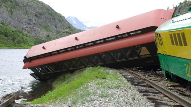 A train derailed July 23 on the White Pass and Yukon Route railway, leaving several passengers injured. The derailment was caused by the failure of metal bar in a switch on the rail line, says the company's president.