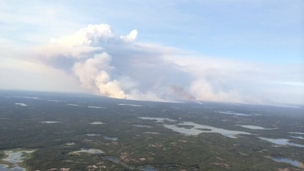 A fire covering approximately 5,000 hectatres burning about 30 kilometres northwest of Yellowknife. Fire crews working at the site set up camp at the Folk on the Rocks site near Yellownife after being smoked out last night.