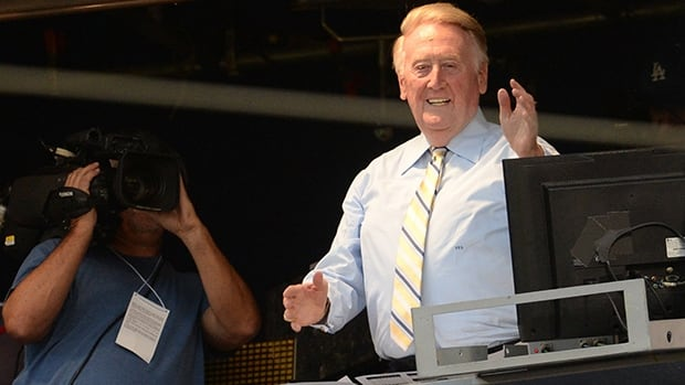 Los Angeles Dodgers broadcaster Vin Scully acknowledges the applause from the booth at Dodger Stadium on Tuesday night.