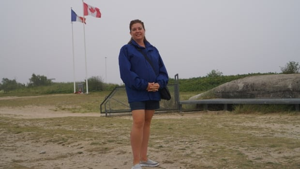 Kamsack high school teacher Wendy Shabatoski on Juno Beach in front of a German bunker.