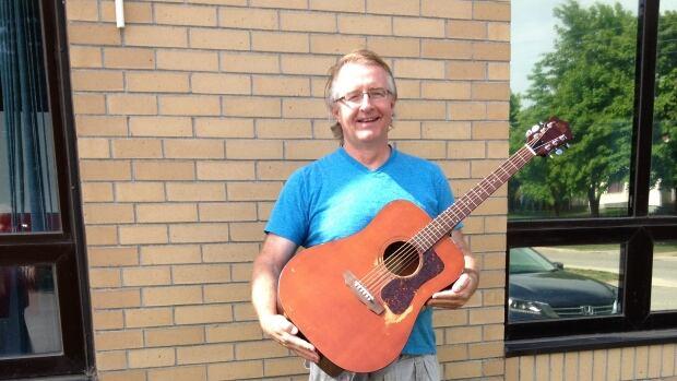 Sheldon McBrearity plays a 1974 Guild D25M guitar.