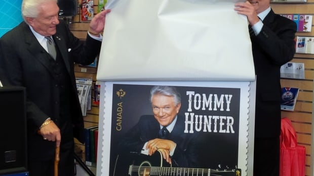 Tommy Hunter unveils his new stamp in a special ceremony in his hometown of London, Ont. He is one of five Canadian country artists honoured in a new postage collection, including k.d. lang, Shania Twain and Renée Martel and Hank Snow