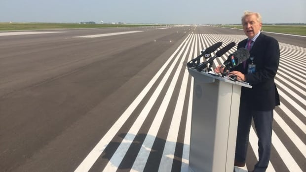 Barry Rempel, president and CEO of the Winnipeg Airports Authority, officially reopens the runway on Thursday.