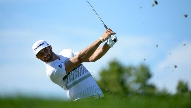 Dustin Johnson tees off on the 13th hole during the first round of the Canadian Open at on July 24, 2014.