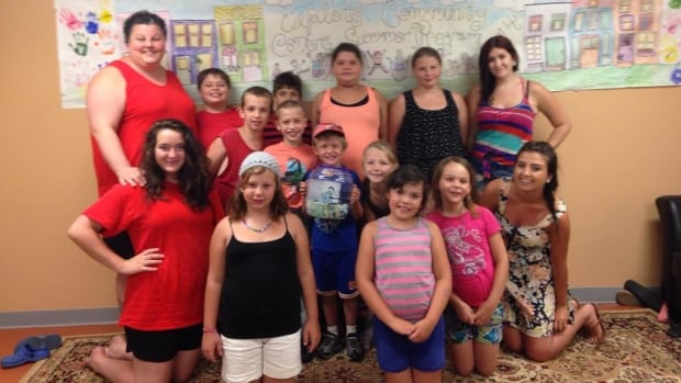 A group of children at the Exploits Community Centre raised $550 through a car wash for Dianne Boyde.