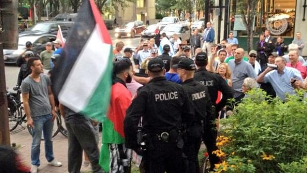 A small group of Palestinian supporters showed up. Police separated them from the larger crowd of Israel supporters.