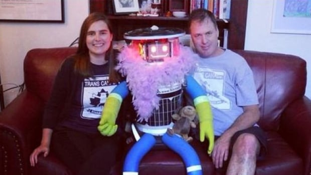 HitchBOT home with its 'family' in Ontario. David Harris Smith (right), an assistant professor at Hamilton's McMaster University, first came up with the idea of creating a collaborative art project centred around a hitchhiking robot.
