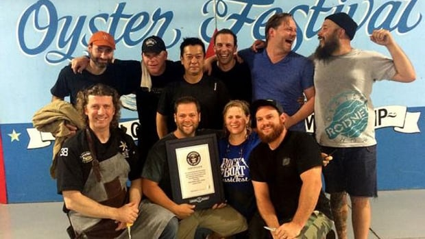 The Tyne Valley Oyster Festival team celebrates setting a new world record in shucking Thursday evening.