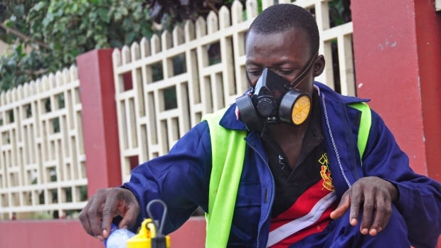 An employee of the Monrovia City Corporation mixes disinfectant before spraying it on the streets in a bid to prevent the spread of  the deadly Ebola virus, in the city of Monrovia, Liberia, on Friday.