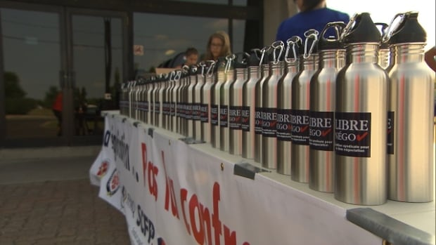 """The coalition leading Friday's anti-pension reform protest offered Quebec Games athletes and spectators water bottles bearing the """"Libre Négo"""" label."""