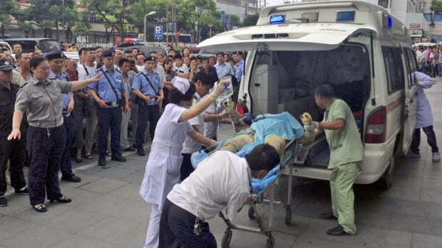 Medical staff move a severely burnt victim of an explosion at an eastern Chinese automotive parts factory from a hospital in the city of Kunshan, Jiangsu Province to a Shanghai hospital, on Aug. 2, 2014 due to lack of hospital equipment to treat severe burns. Dozens of people were killed Saturday by the explosion at the factory that supplies General Motors, state media reported.