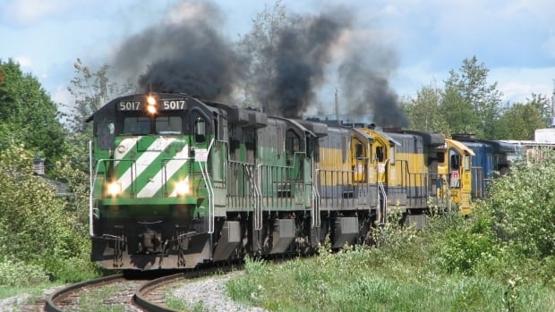 The MMA locomotive that led the train that crashed in Lac-Mégantic is pictured going through Nantes, Que. on June 7, 2010. Dozens of locomotives once owned by the railroad responsible for last year's deadly derailment in Lac-Mégantic, Quebec have been sold at an auction in Maine, except for the lead locomotive which was pulled from the auction at the request of Quebec provincial police.
