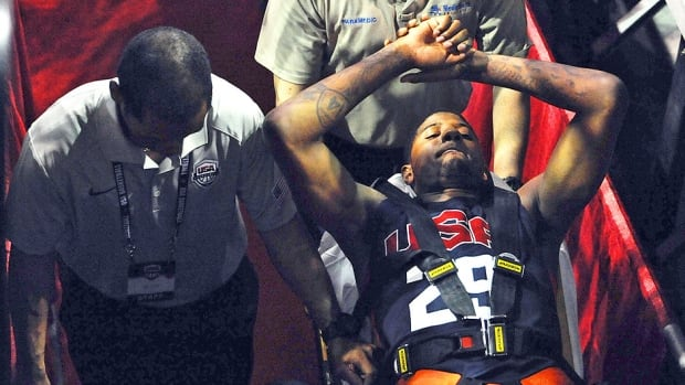 The Pacers' Paul George is carted off the court after breaking his right leg during the USA Basketball Showcase intrasquad game in Las Vegas on Friday. He has had surgery and is expected to remain in hospital for about three days.