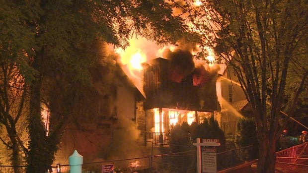 Flames engulfed two vacant homes in the 1000 block of Keefer Street early in the morning hours of Saturday, Aug. 2, 2014.