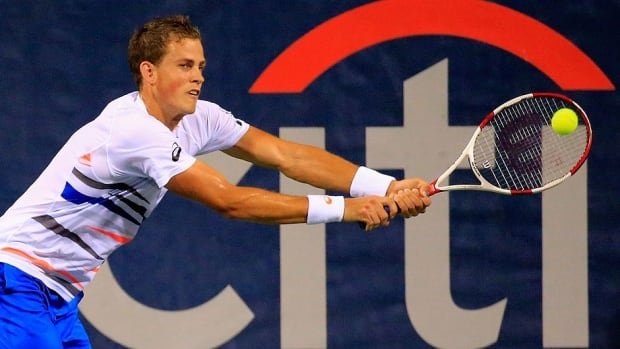 Canada's Vasek Pospisil returns a shot to Santiago Giraldo of Colombia during quarter-final play at the Citi Open in Washington, D.C., on Saturday. Pospisil prevailed 6-7 (4), 6-3, 6-4 and was scheduled to play in the semifinals later in the day.
