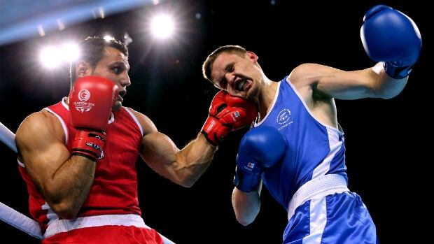 Canada's Samir El-Mais, left, lands a punch on David Light of New Zealand in the gold medal bout of the men's 91 kg classification at the Commonwealth Games.