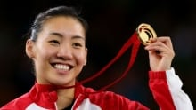 Commonwealth Games: Michelle Li wins historic badminton gold