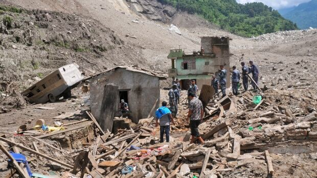 Nepalese security personnel gather for rescue work at the site of the landslide in Sindhupalchowk area, 120 kilometres east of Katmandu.