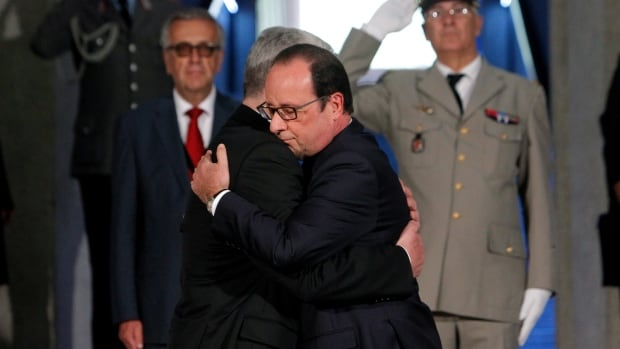 France's President Francois Hollande, left, and German President Joachim Gauck arrive to attend Sunday's ceremony in eastern France to mark the 100th anniversary of the outbreak of the First World War I.