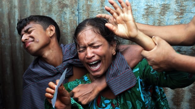A Bangladeshi woman whose daughters are missing cries as rescuers search the River Padma after a passenger ferry capsized in Munshiganj district, Bangladesh, on Monday.