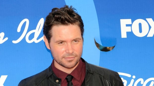 Michael Johns arrives at the American Idol finale at the Nokia Theatre at L.A. Live in Los Angeles in 2013. Johns appeared in season 7 of the hit Fox singing competition.