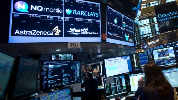 Traders work on the floor of the New York Stock Exchange Monday. The Dow Jones industrial average, The Standard & Poor's 500 Index and the Nasdaq Composite Index all rose.