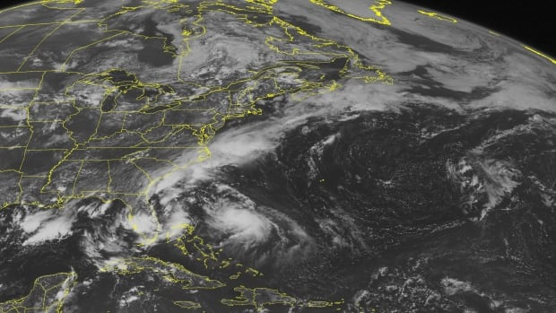 This NOAA satellite image taken Monday shows an area of dense cloud cover northeast of the Bahamas associated with Hurricane Bertha. Another prominent area of clouds extends from the North Atlantic southwestward along the Eastern Seaboard into Florida due to a stationary boundary, with rain and thunderstorms.
