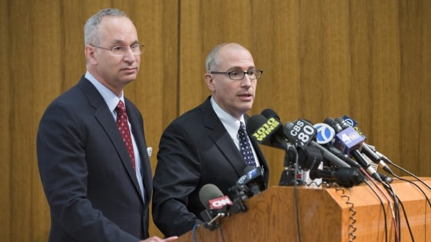 "Jeremy Boal, right, chief medical officer for the Mt. Sinai Health System in New York City, tells reporters during a news conference Monday that ""odds are it is not Ebola"" causing a high fever and stomach ache in a male patient who came into the ER on Monday, but the man has been put in strict isolation nonetheless. David Reich, president of Mount Sinai Hospital, looks on."