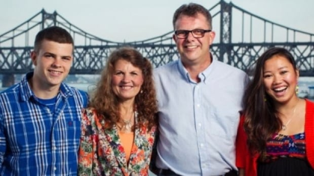 Kevin and Julia Dawn Garratt, shown here flanked by their son Peter and daughter Hannah, are being investigated by Chinese authorities for allegedly stealing state secrets. The Canadian couple own a coffee shop in Dandong, a Chinese city near the North Korean border.