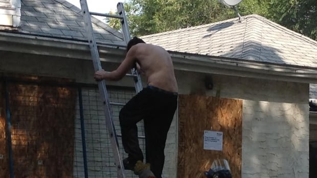 Man rescued from roof of burning house.